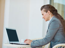 Happy business woman working with laptop Stock Images