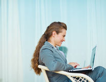 Happy business woman working with laptop Stock Photography