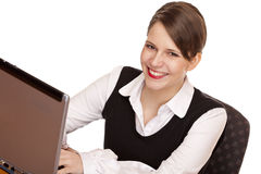 Happy business woman works on compputer Stock Images