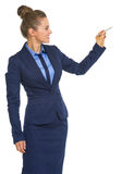 Happy business woman writing in air with pen Royalty Free Stock Image