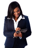 Happy business woman writing on digital tablet Royalty Free Stock Photo