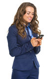 Happy business woman writing sms Royalty Free Stock Photography