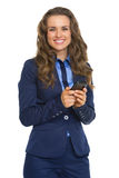 Happy business woman writing sms Royalty Free Stock Photos
