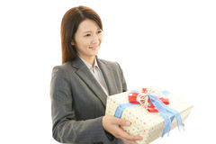 Happy business women with a gift Stock Images