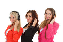Happy business women with headset. Happy young business women with headset on a white background. Operators of support service stock images