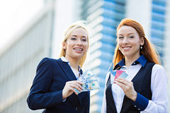 Happy business women holding credit cards and cash reward Stock Photo