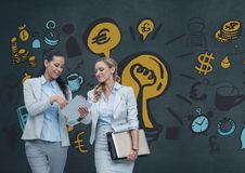 Happy business women looking at a tablet against blue background with graphics. Digital composite of Happy business women looking at a tablet against blue Stock Image