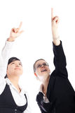 Happy business women pointing up Stock Images
