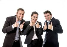 Happy business works smiling with their thumbs up. Happy business workers with their tubs up smiling wearing suits on a white background Stock Photos