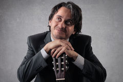 Happy businessan with a guitar stock photo