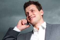Happy businessman. Handsome, young businessman in suit Royalty Free Stock Photography