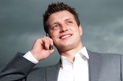 Happy businessman. Handsome, young businessman in suit Stock Image