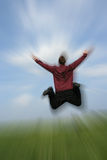 Happy businessman. Pcture of a business man jumping with arms wide open, the picture has a zoom effect Stock Image