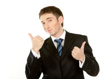 Happy businessman. Showing his thumb up with smile Royalty Free Stock Photography