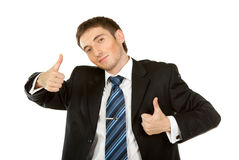 Happy businessman. Showing his thumb up with smile Royalty Free Stock Photo