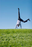 Happy businessman. Doing somersault on grass Stock Photography