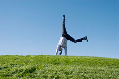 Happy businessman. Doing somersault on grass Stock Image