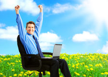 Happy businessman. Successful happy businessman with laptop under blue sky Stock Photos
