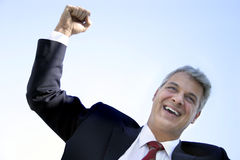 Happy businessman. Businessman celebrating a good deal Royalty Free Stock Photo
