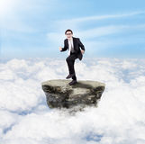 Happy businessman above clouds Royalty Free Stock Image