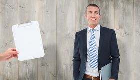 Composite image of happy businessman. Happy businessman against wooden planks Royalty Free Stock Photos