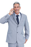 Happy businessman answering phone Royalty Free Stock Images