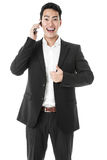 Happy Businessman answering a phone call Royalty Free Stock Image