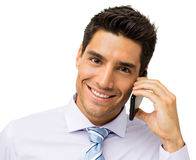 Happy Businessman Answering Smart Phone Stock Image