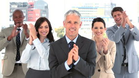 Happy businessman applauding while standing Royalty Free Stock Photo