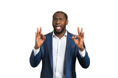 Happy businessman approving good job. Ok hand gesture of cheerful businessman. Business success concept stock image