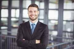 Happy businessman with arms crossed Royalty Free Stock Photos