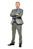 Happy businessman arms folded isolated on white Stock Image