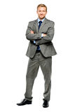 Happy businessman arms folded isolated on white Royalty Free Stock Photo