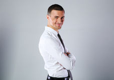 Happy businessman with arms folded Royalty Free Stock Photo