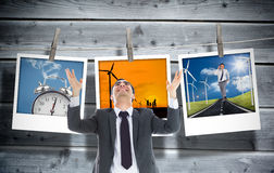 Happy  businessman with arms raised Stock Photo