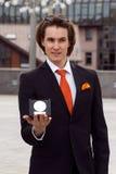 Happy Businessman with award on urban background Royalty Free Stock Photos
