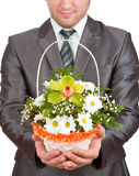 Happy businessman with basket of flowers Royalty Free Stock Photography