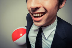 Happy businessman with beach ball Stock Images