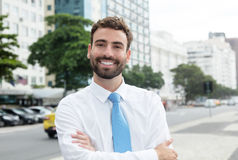 Happy businessman with beard and blue tie in the city Royalty Free Stock Image