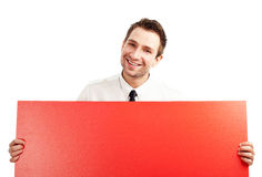 Happy businessman with blank red billboard. Happy businessman holding red blank billbard. Isolated on white Stock Photography