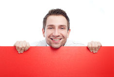 Happy businessman with blank red billboard. Businessman holding red blank billbard. Isolated on white Stock Photography