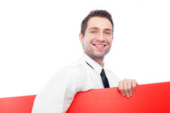 Happy businessman with blank red billboard. Happy businessman holding red blank billbard. Isolated on white Royalty Free Stock Images