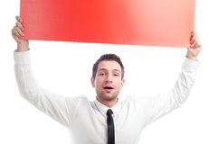 Happy businessman with blank red billboard. Happy businessman holding red blank billbard. Isolated on white Stock Image