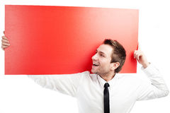 Happy businessman with blank red billboard. Happy businessman holding red blank billbard. Isolated on white Stock Photos