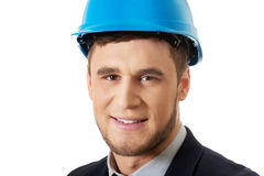 Happy businessman with blue hard hat. Royalty Free Stock Image