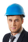 Happy businessman with blue hard hat. Royalty Free Stock Photography
