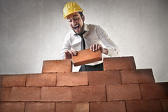 Happy businessman building royalty free stock image