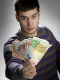 Happy businessman with bundle of euro money Royalty Free Stock Photos