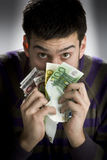 Happy businessman with bundle of euro money Royalty Free Stock Image