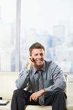 Happy businessman calling on couch Royalty Free Stock Photos